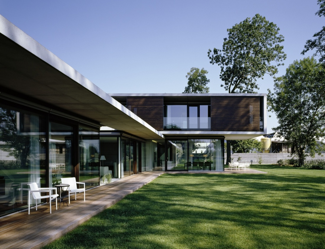 Wood Deck, Glass Walls, Cantilevered House in the Town of Hard, Austria