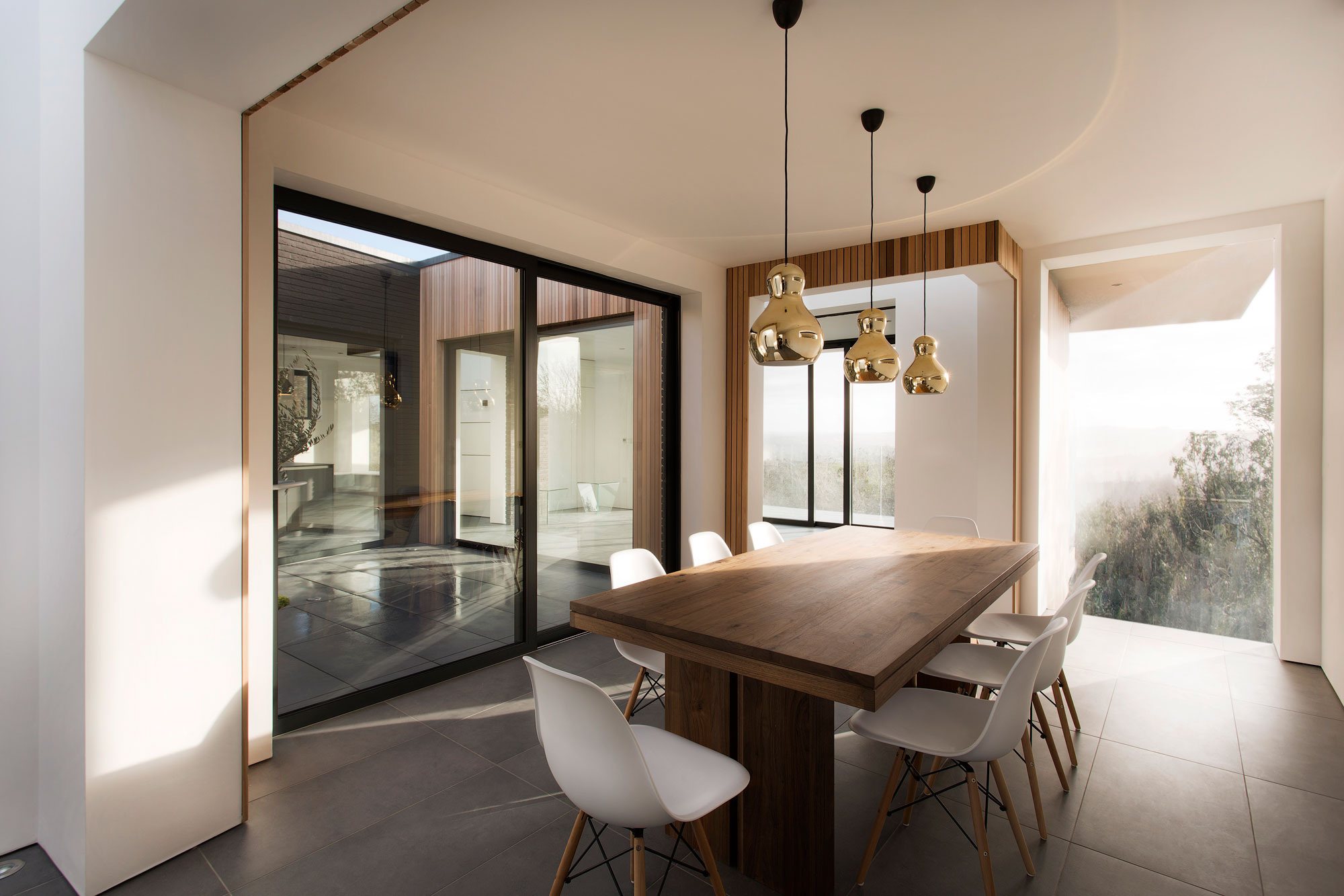 Dining Table, Patio Doors, Gold Pendant Lights, Modern Home In Hampshire,  England