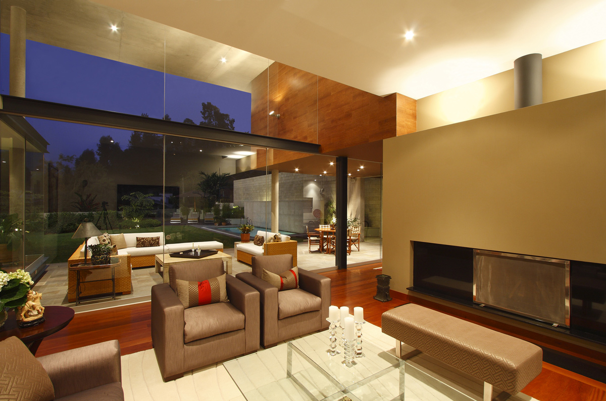 Fireplace, Glass Table, Rug, Evening Lighting, Family Home in Lima, Peru