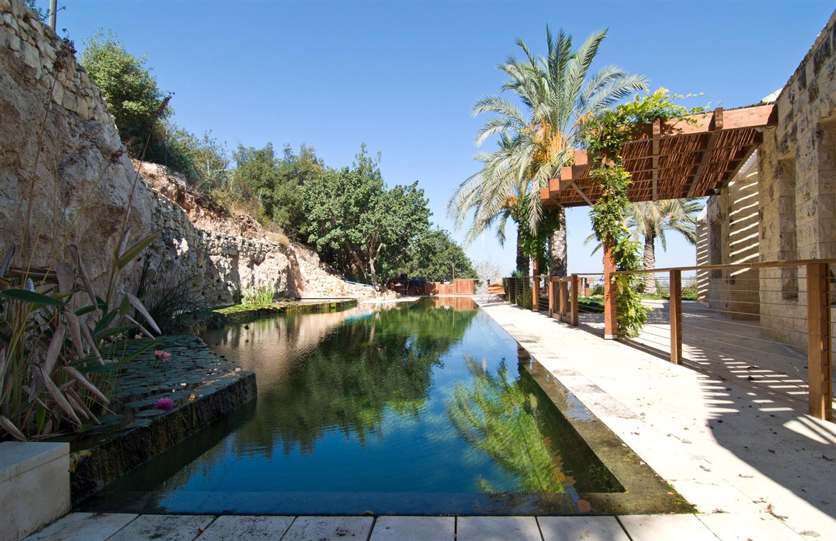 Natural Swimming Pool, Cliff, Contemporary Stone House in Jerusalem, Israel