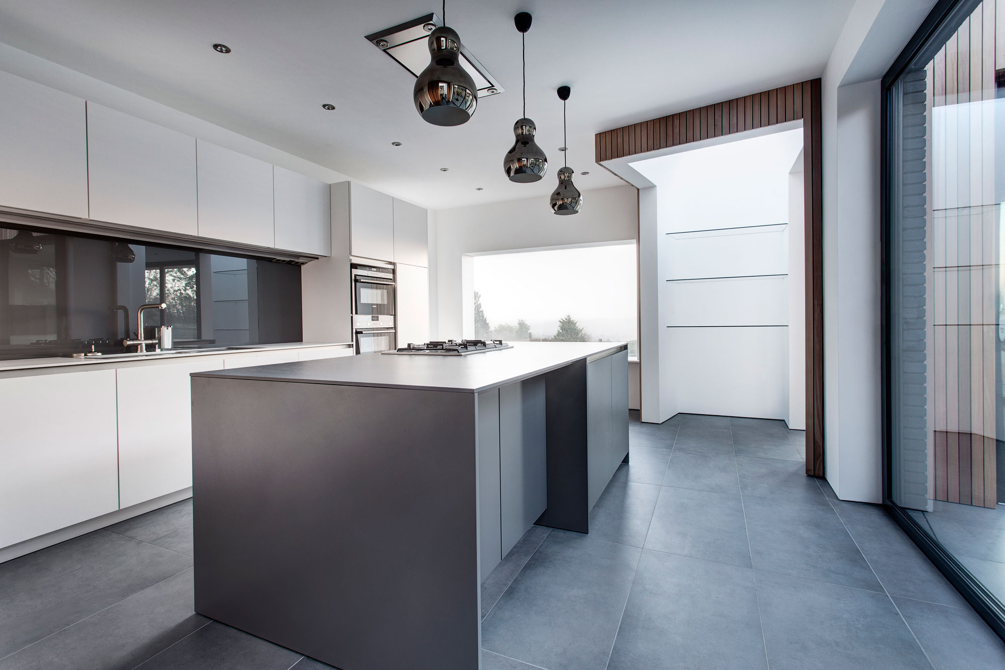 Grey And White Kitchen With Island white & grey kitchen, island, pendant lighting, modern home in