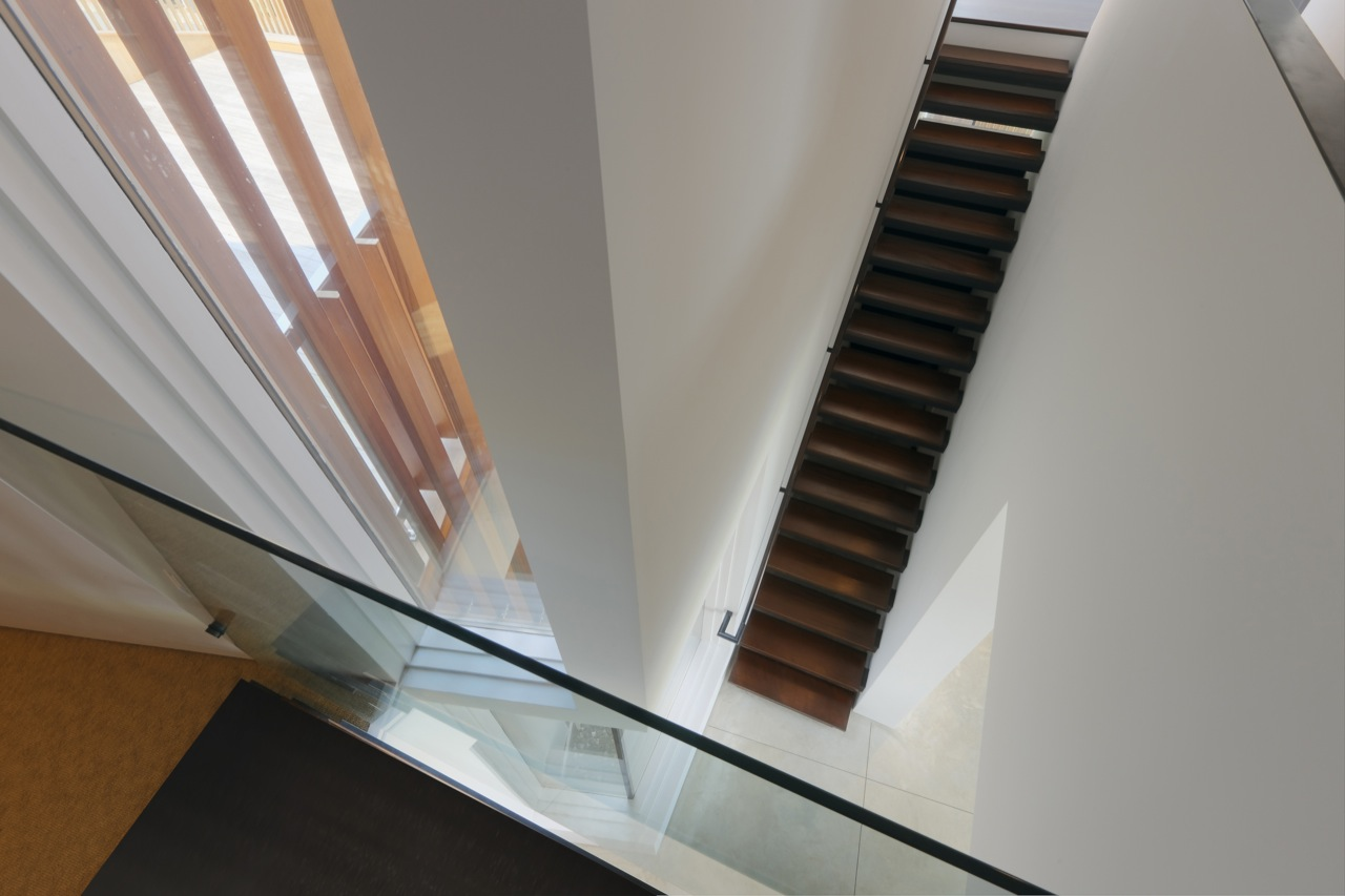 Dark Staircase, White Walls, Oceanfront Residence in Connecticut