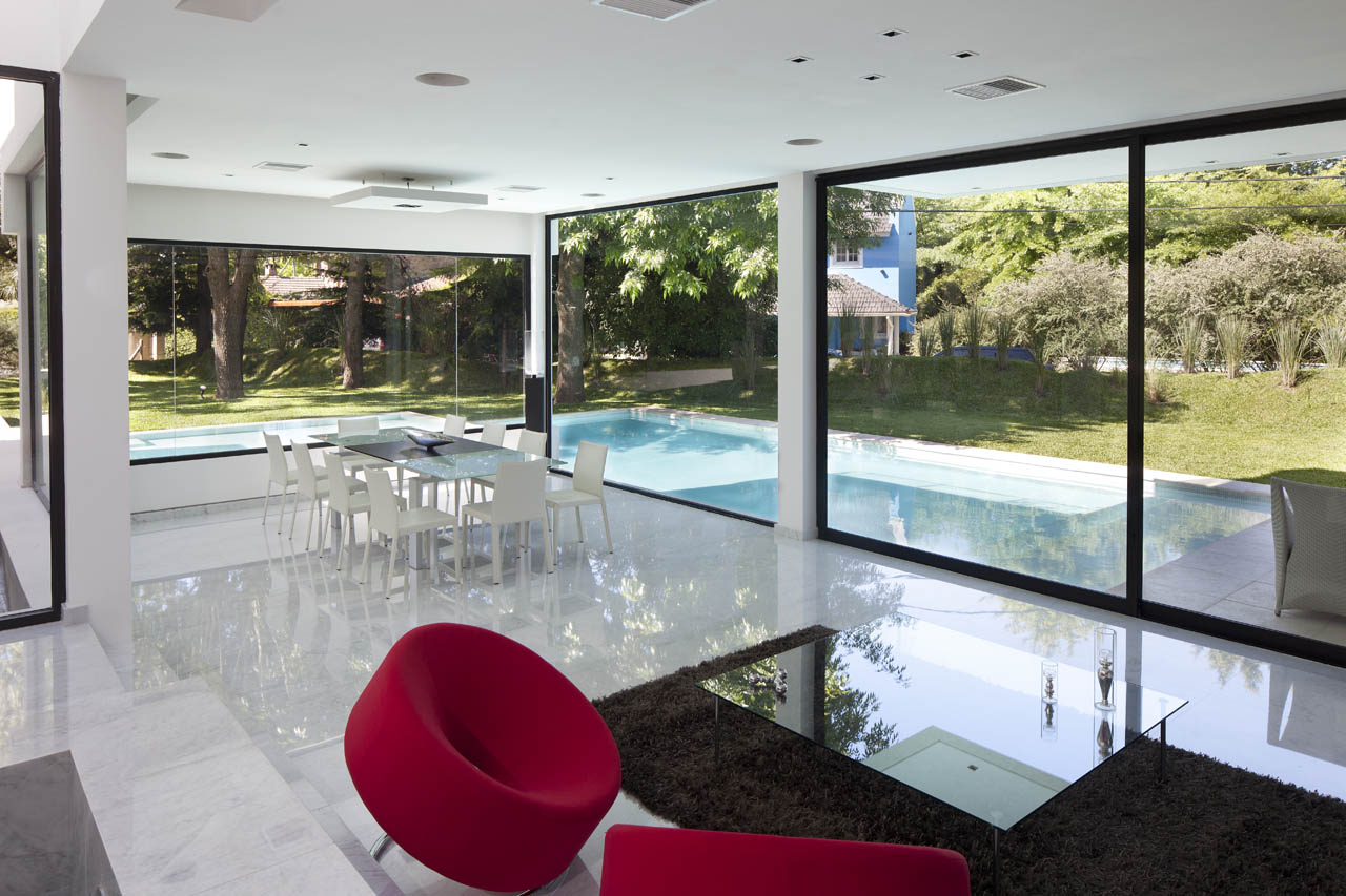 Dining Table, Rug, Coffee Table, Red Seating, Glass Sliding Doors, Modern House in Pilar, Buenos Aires