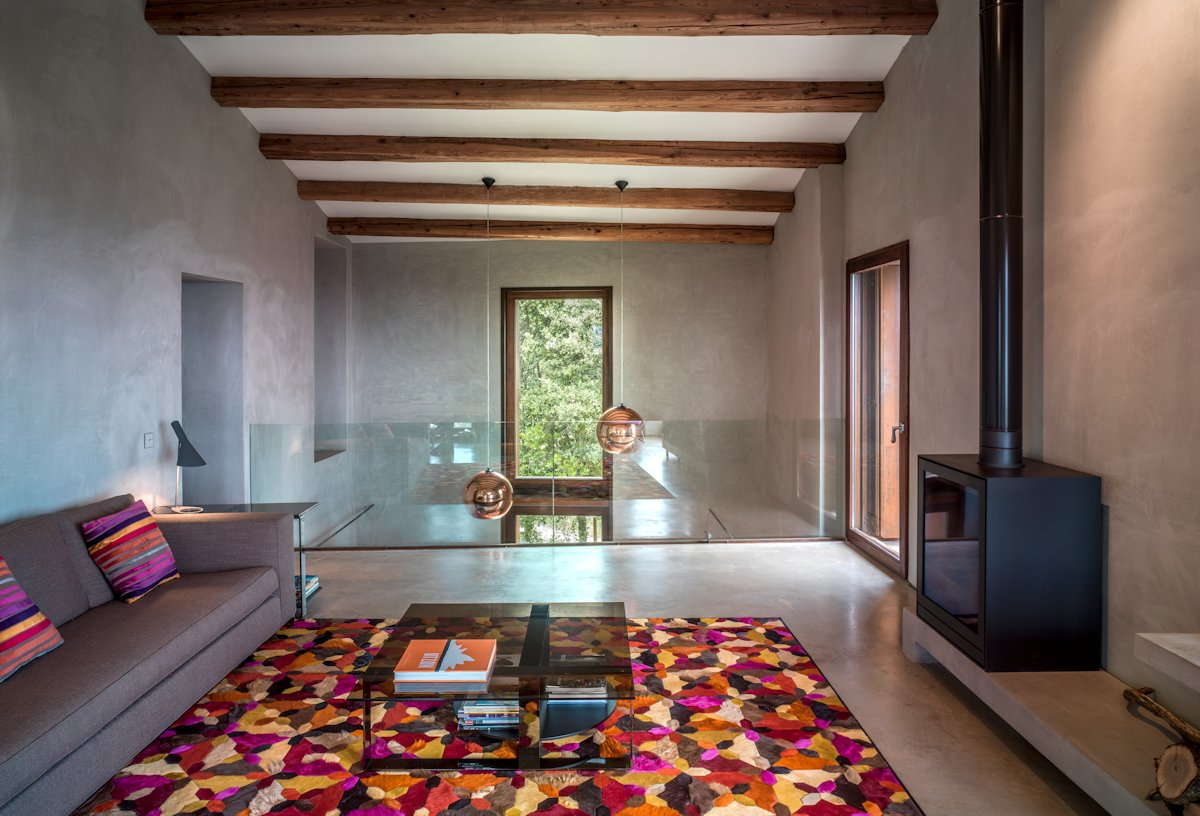 Mezzanine, Fireplace, Glass Balustrading, Gold Pendant Lighting, Rug Catalan Farmhouse, Girona, Spain