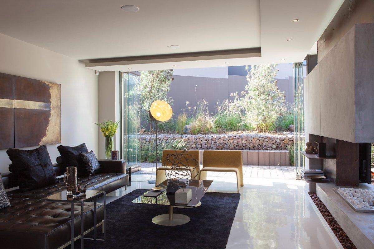 Modern Fireplace, Dark Rug, Sofa, House in Johannesburg