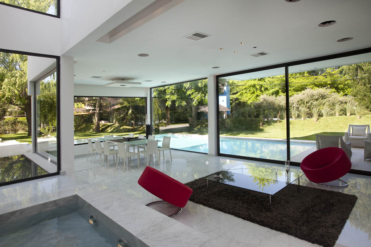 Water feature open plan living space modern house in for Modern open plan houses