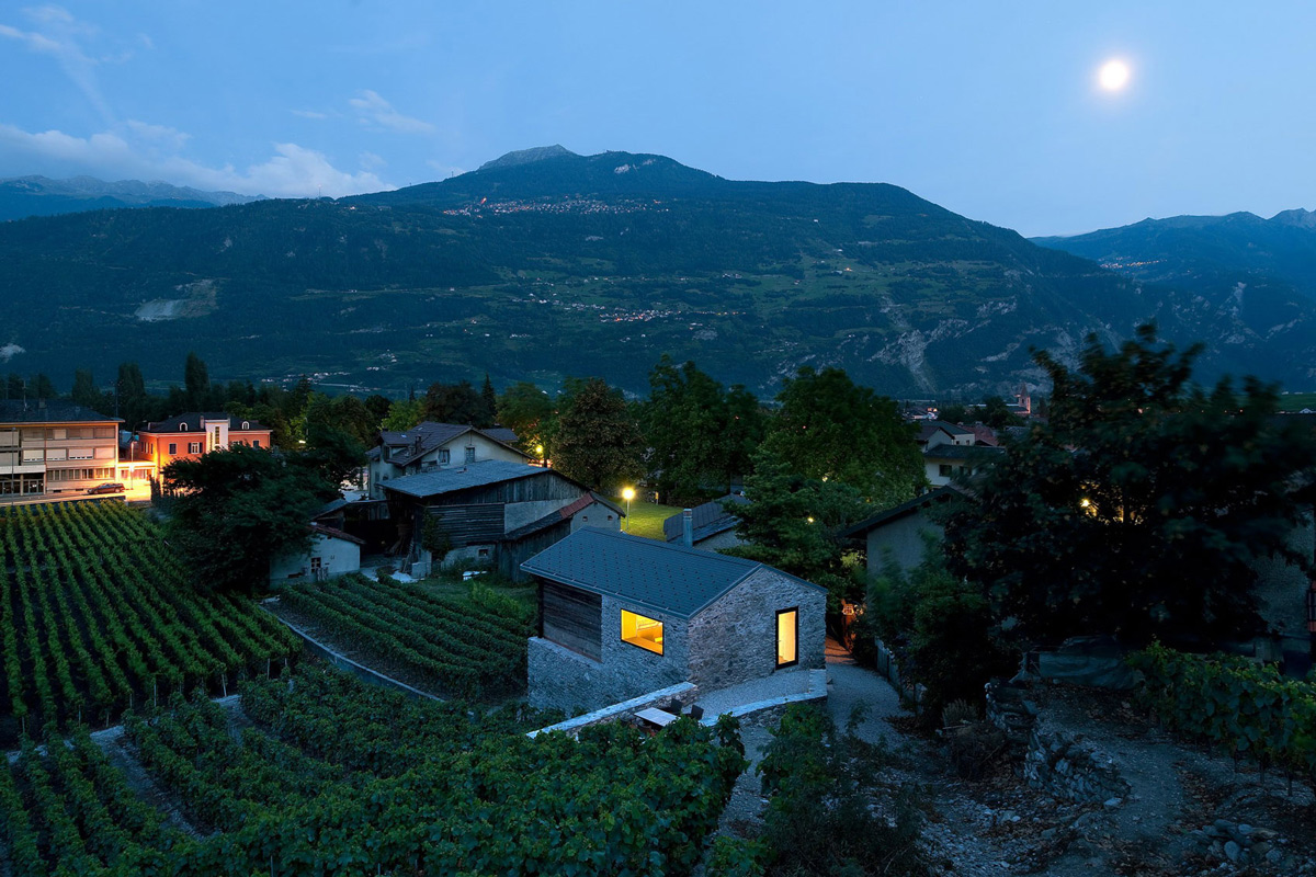 Evening Lighting, Grape Vines, Mountain Views, Home Remodel in Vétroz, Switzerland