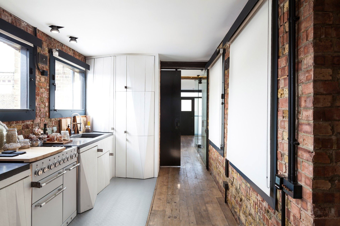 Kitchen, Wooden Flooring, Brick Walls, Archer Street Apartment in London, England