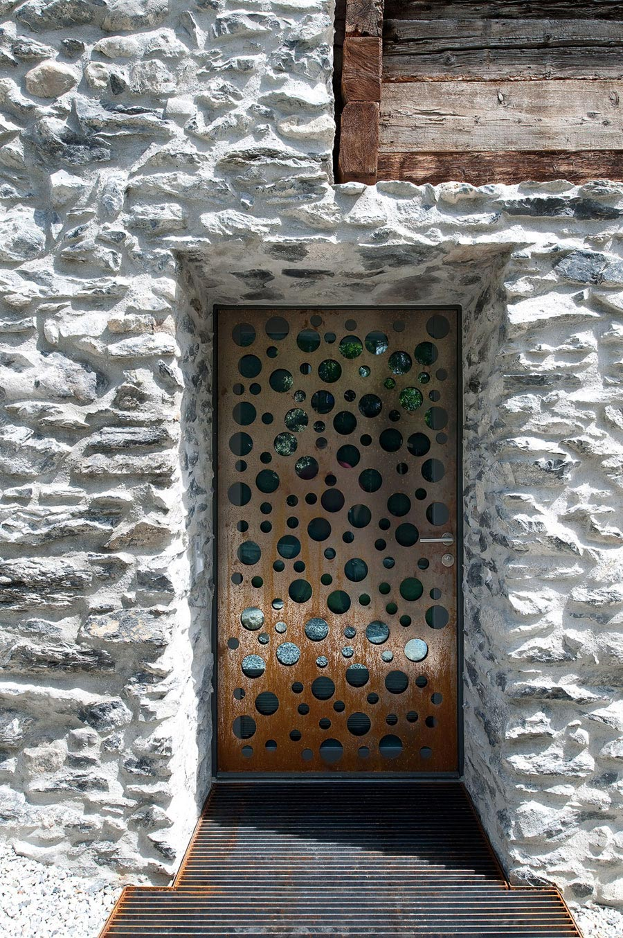 Metal Door, Stone Walls, Home Remodel in Vétroz, Switzerland