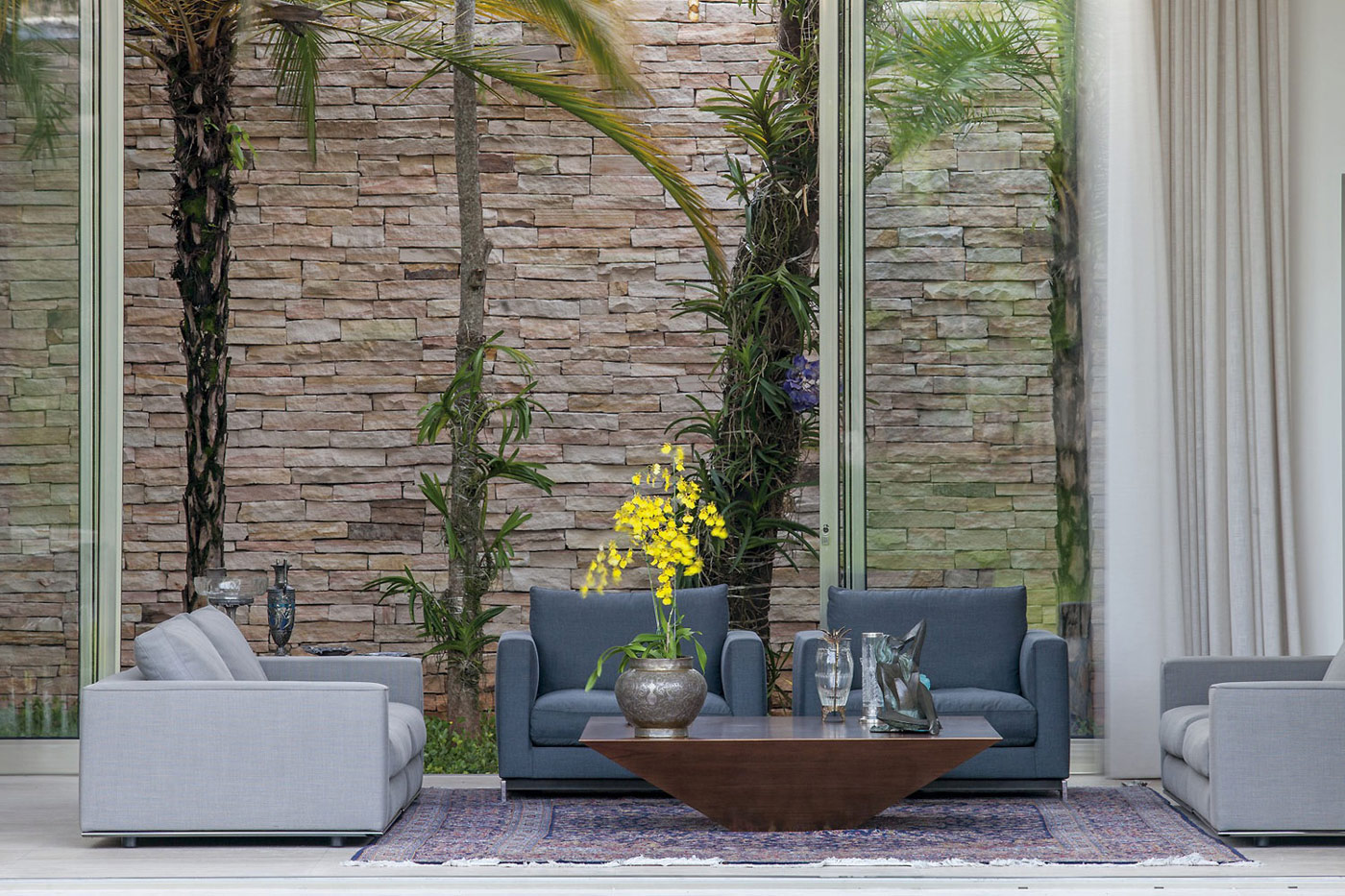 Stone Wall, Sofas, Coffee Table, Home in Uberlandia, Brazil