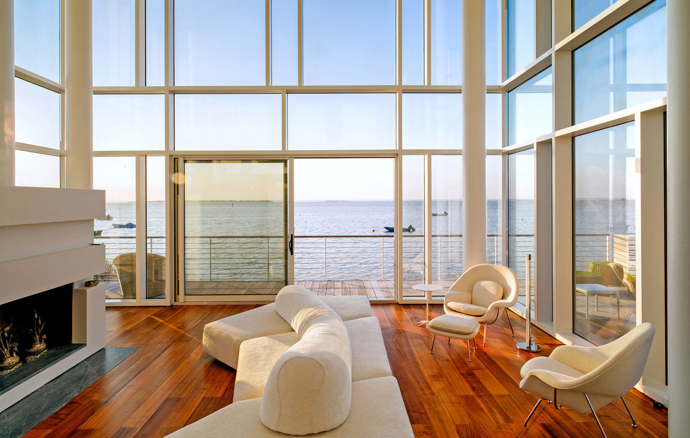 Living Room, Fireplace, Dark Wood Flooring, Glass Walls, Richard Meier's Fire Island House