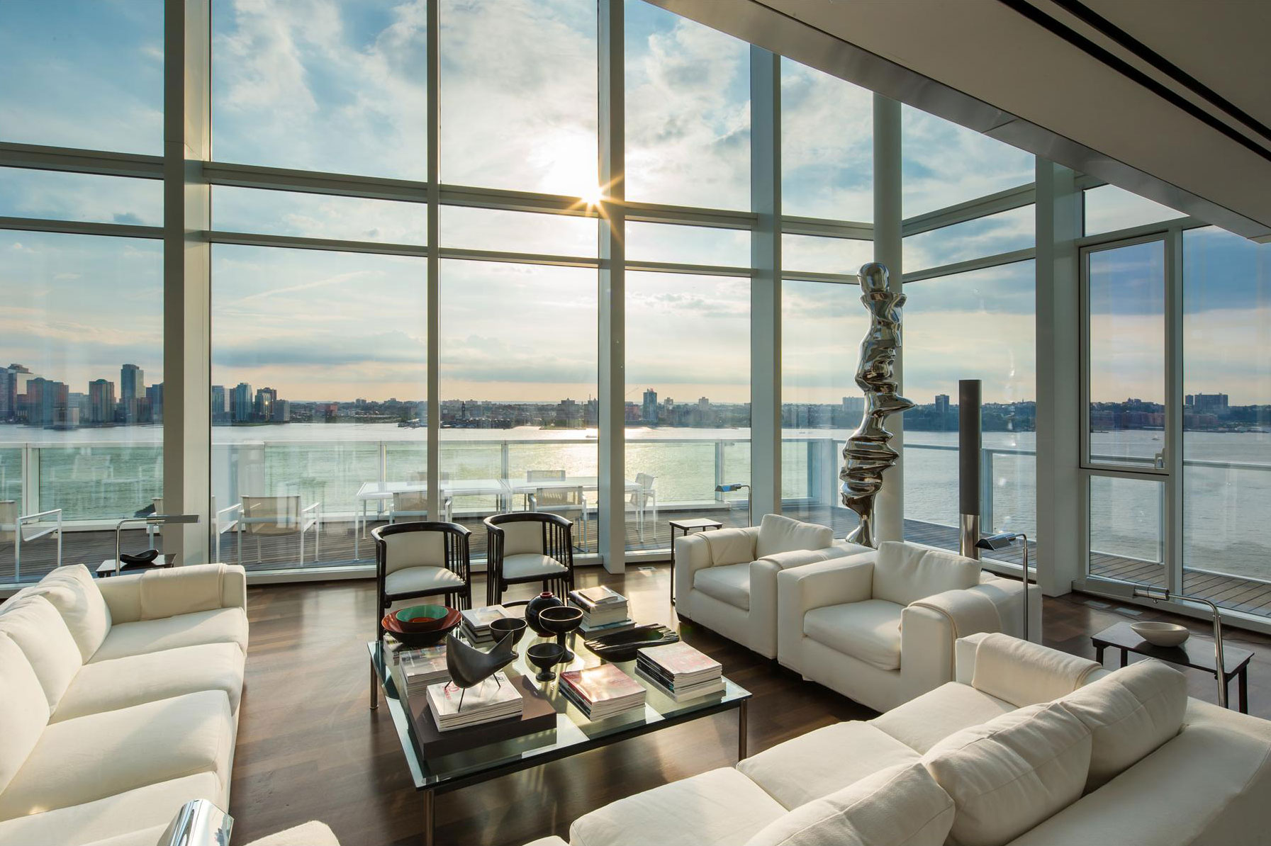 sofas glass coffee table floor to ceiling windows apartment in manhattan - Breathtaking Beach Houses In New York