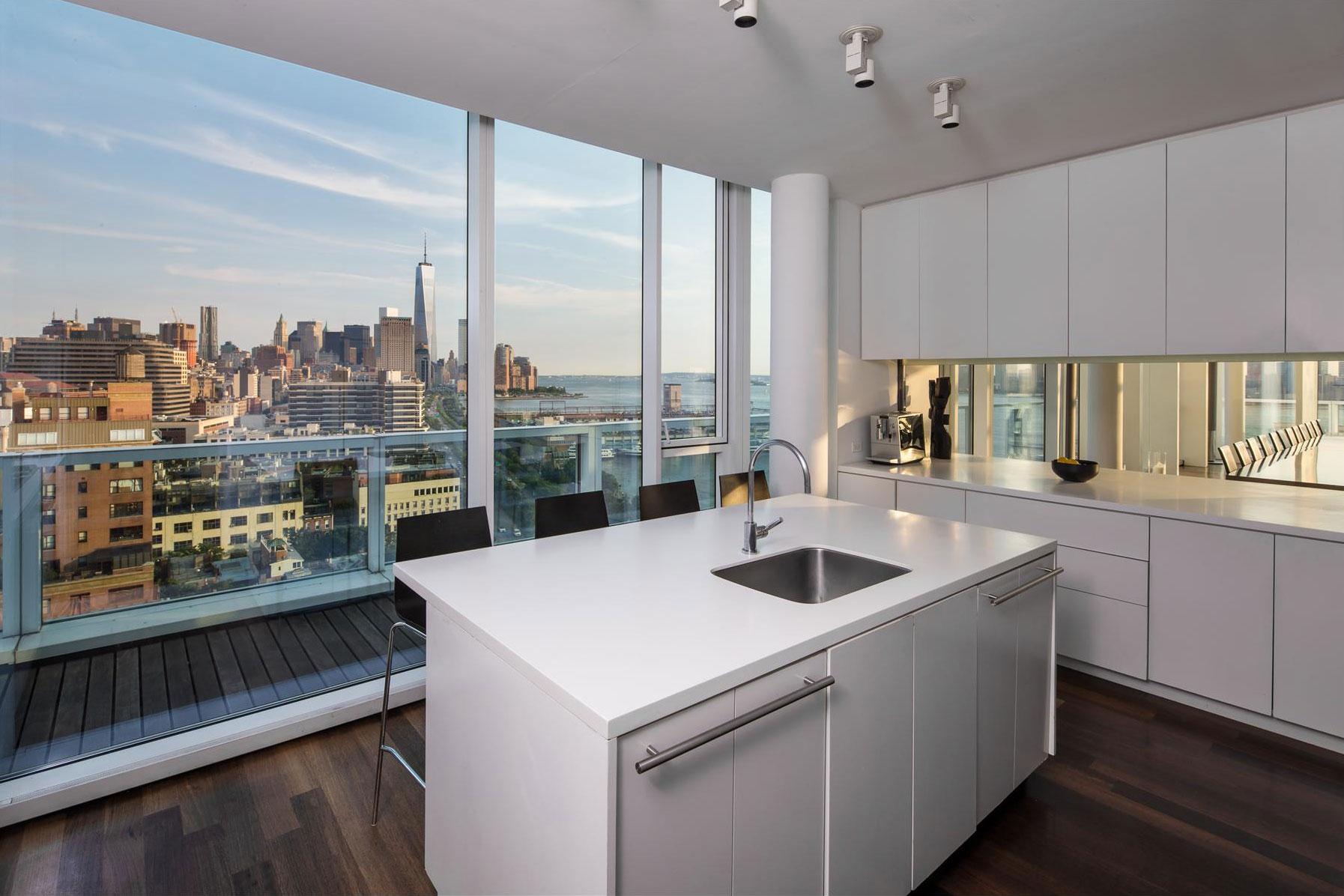 White Kitchen, Dark Wood Flooring, Apartment in Manhattan