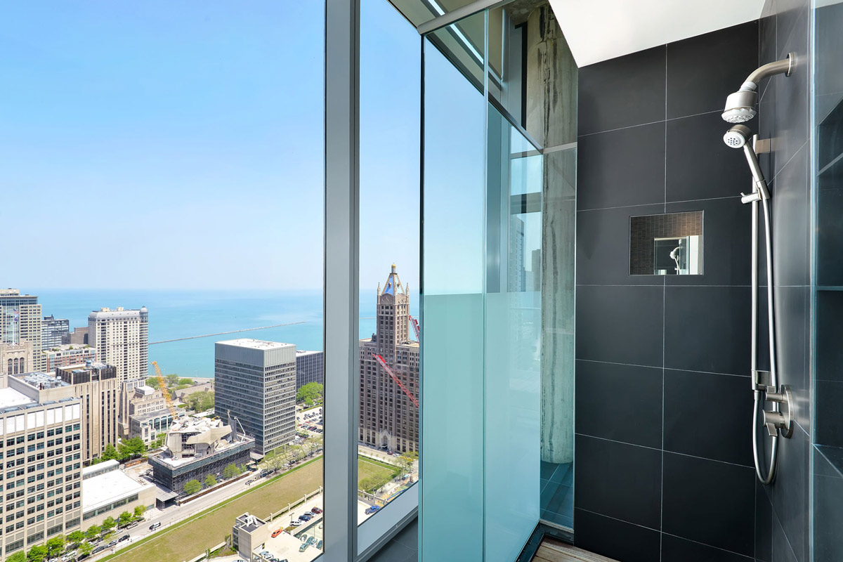 Shower, floor-to-ceiling windows