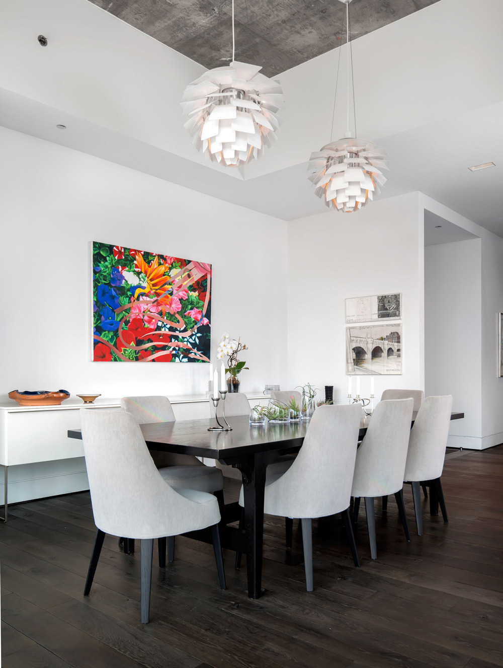 White pendant lights, dining chairs