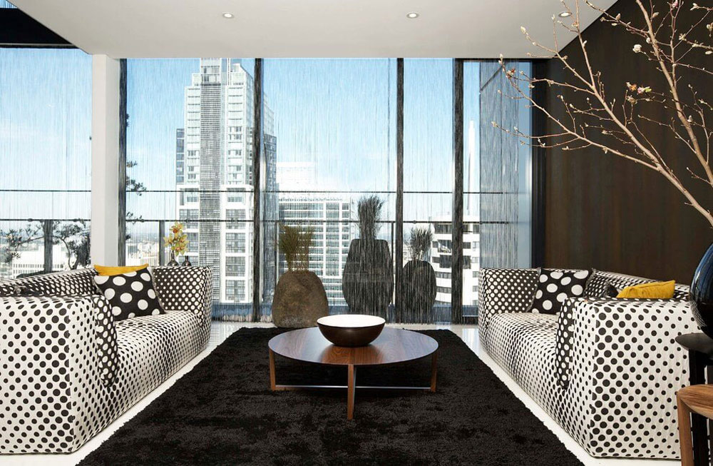 Black rug, Polka dot sofas