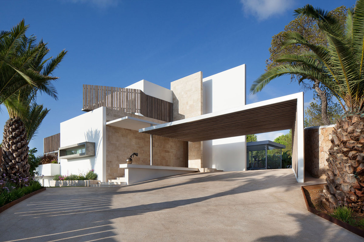 Beach villa in roca llisa ibiza with panoramic sea views for Contemporary carport design architecture