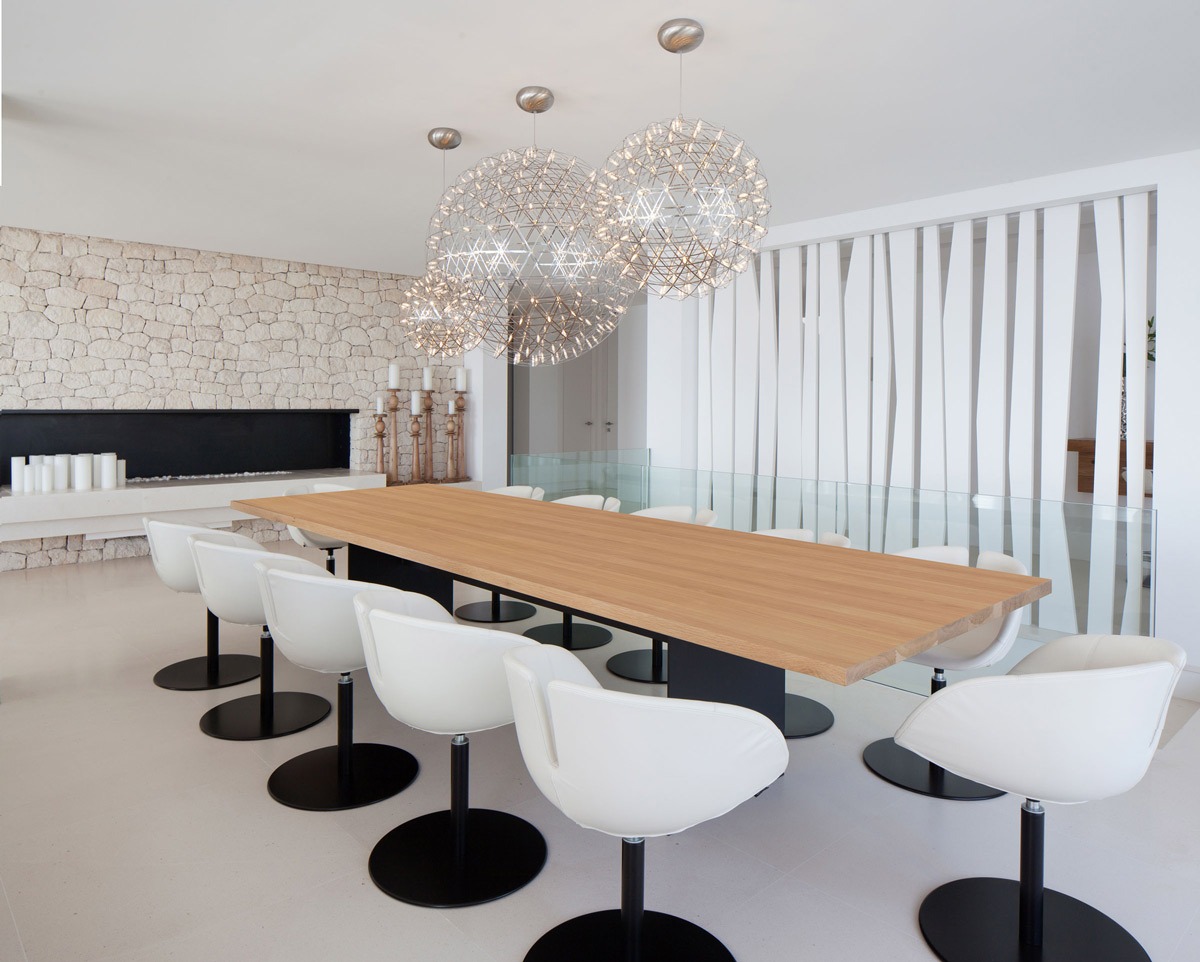 Modern fireplace, dining table with pendant lighting