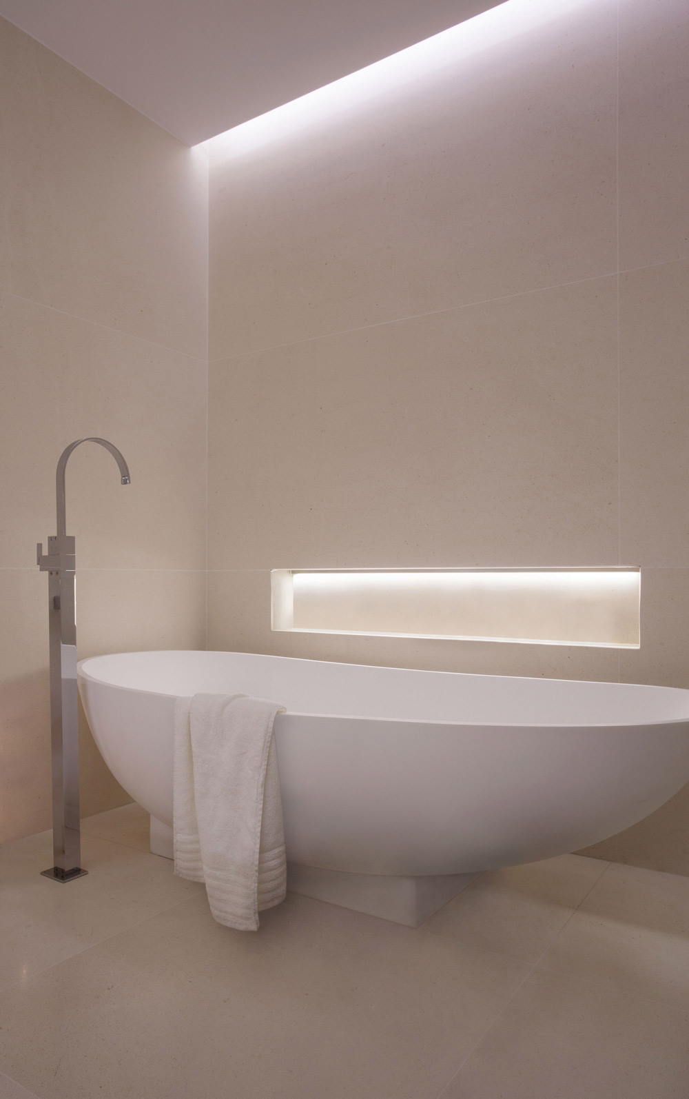 Modern white bath with recessed lighting