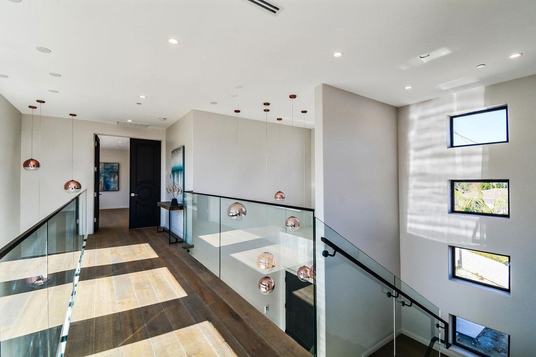 Upstairs hallway, glass balustrading