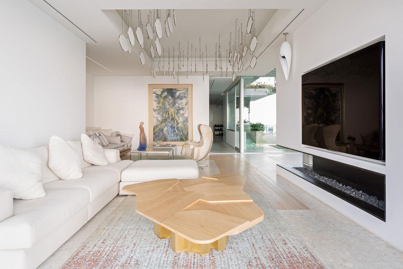 White sofa, coffee table, rug