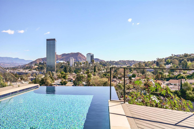 Infinity pool city & mountain views